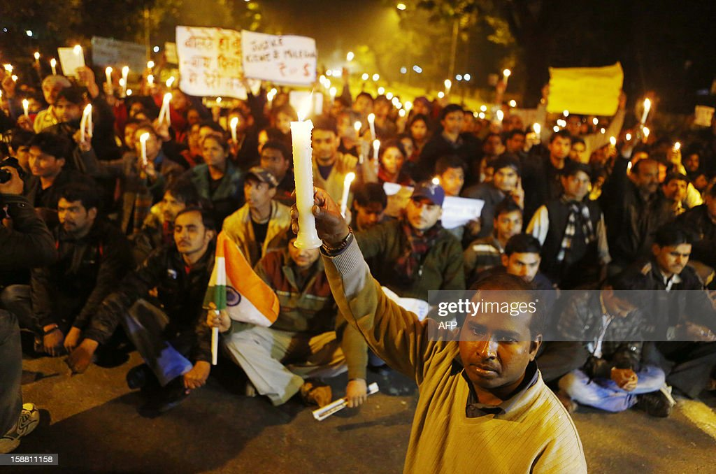 Indian protesters hold candles while temporarily blocking a road during a rally in New Delhi on December 30, 2012, following the cremation of a gangrape victim in the Indian capital. The victim of a gang-rape and murder which triggered an outpouring of grief and anger across India was cremated at a private ceremony, hours after her body was flown home from Singapore. A student of 23-year-old, the focus of nationwide protests since she was brutally attacked on a bus in New Delhi two weeks ago, was cremated away from the public glare at the request of her traumatised parents.