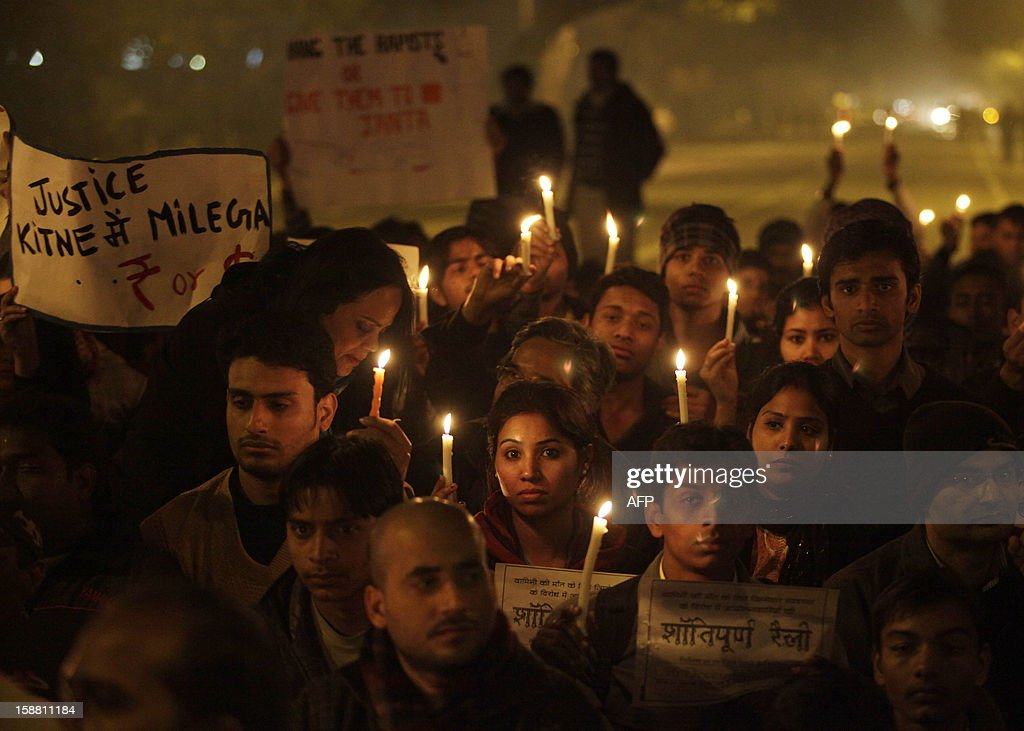Indian protesters hold candles while temporarily blocking a road during a rally in New Delhi on December 30, 2012, following the cremation of a gangrape victim in the Indian capital. The victim of a gang-rape and murder which triggered an outpouring of grief and anger across India was cremated at a private ceremony, hours after her body was flown home from Singapore. A student of 23-year-old, the focus of nationwide protests since she was brutally attacked on a bus in New Delhi two weeks ago, was cremated away from the public glare at the request of her traumatised parents. AFP PHOTO/ ANDREW CABALLERO-REYNOLDS