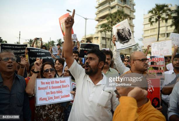 Indian protesters hold placards as they shout slogans in a rally condemning the killing of journalist Gauri Lankesh in Mumbai on September 6 2017...