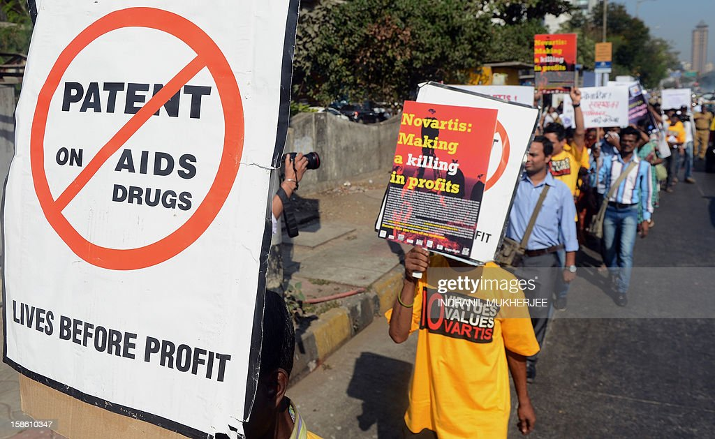 Indian protesters hold placards during a demonstration against Swiss drug manufacturer Novartis, outside their offices in Mumbai on December 21, 2012. Demonstrators including cancer patients were protesting against the potential impact of the company's legal battle in India. Novartis is engaged in a legal battle over a part of the country's patent law that led to the company being denied a patent by an Indian court on their cancer drug 'Gleevec'.