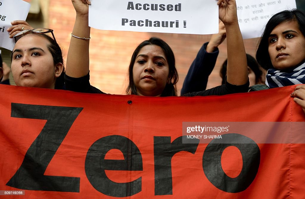 Indian protesters hold placards during a protest outside The Energy and Resources Institute (TERI) office against the Vice-Chairman R. K. Pachauri in New Delhi on February 12, 2016. The TERI governing council has called for an urgent meeting to discuss Pachauri's position while awating a court decision on a year-old sexual harassment charge against him. AFP PHOTO / Money SHARMA / AFP / MONEY SHARMA