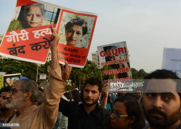 Indian protesters hold placards in a rally condemning the killing of journalist Gauri Lankesh in Mumbai on September 6 2017 Indian activists...