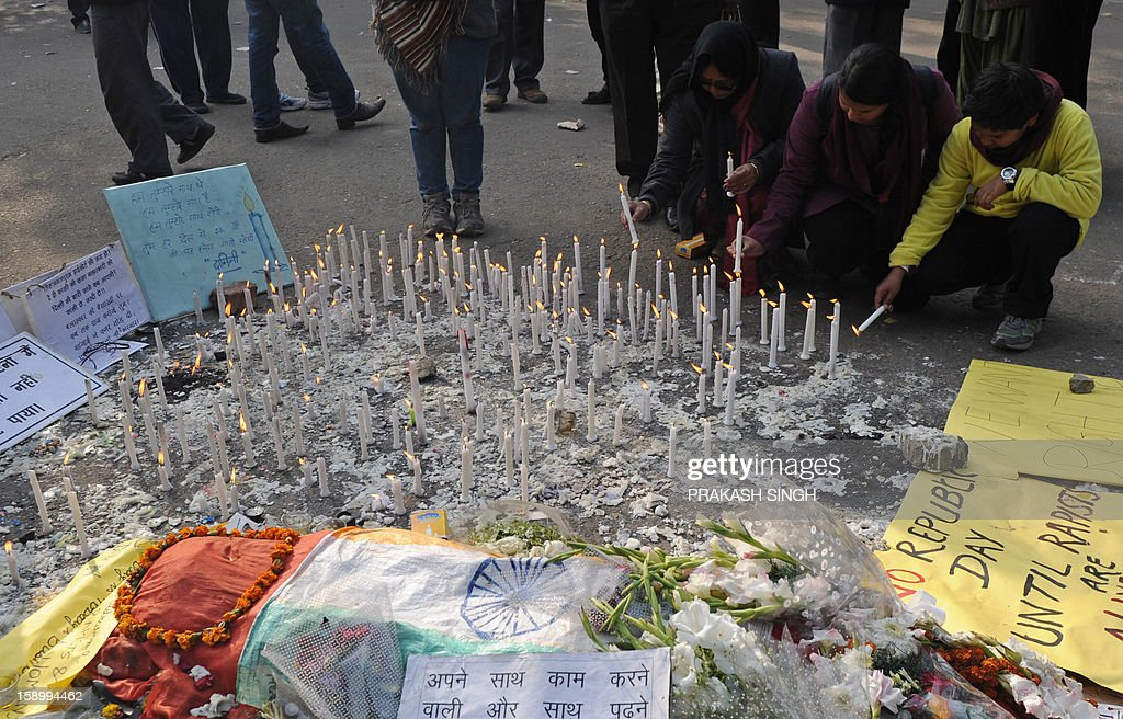 Indian protesters light candles around a mannequin representing the rape victim while paying tribute during a rally in New Delhi on January 5, 2013. Claims of police incompetence and public apathy stirred new anger in the Delhi gang-rape case after the boyfriend of the victim recounted details of the savage attack for the first time. The man was the only witness to the gang-rape of his girlfriend by six men on a moving bus on December 16 which has stirred sometimes violent protests against the treatment of women in Indian society and an apparent rise in sex crime. AFP PHOTO/ Prakash SINGH
