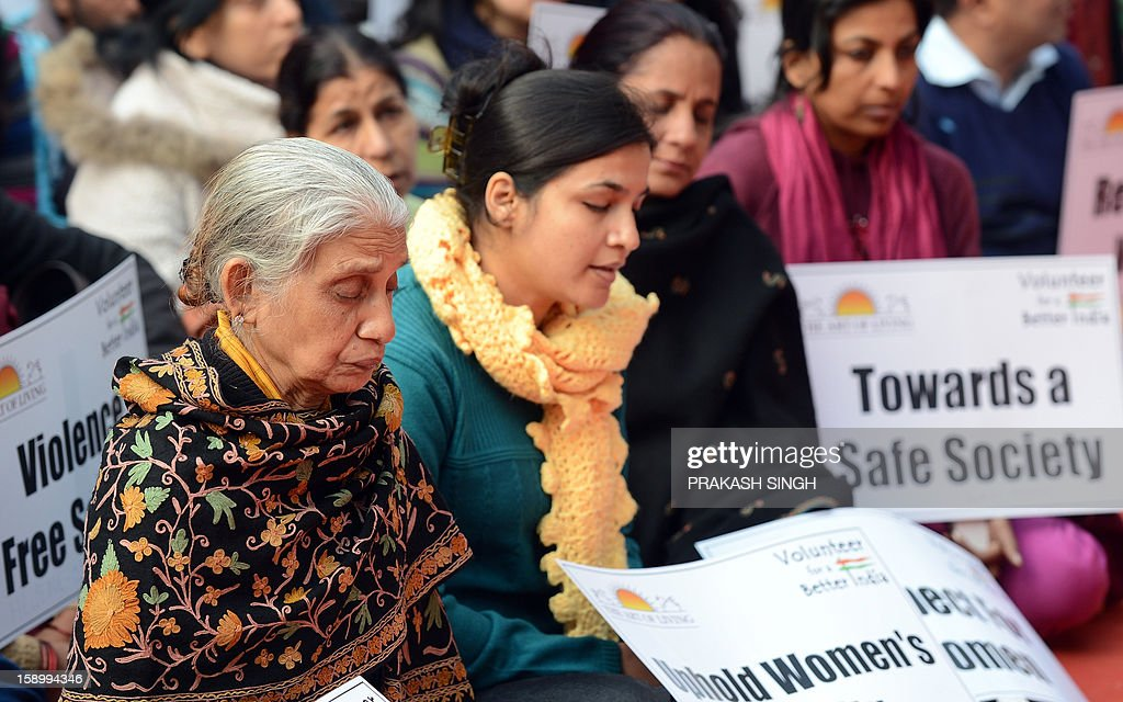 Indian protesters participate in a prayer meeting for the rape victim in New Delhi on January 5, 2013. Claims of police incompetence and public apathy stirred new anger in the Delhi gang-rape case after the boyfriend of the victim recounted details of the savage attack for the first time. The man was the only witness to the gang-rape of his girlfriend by six men on a moving bus on December 16 which has stirred sometimes violent protests against the treatment of women in Indian society and an apparent rise in sex crime. AFP PHOTO/ Prakash SINGH