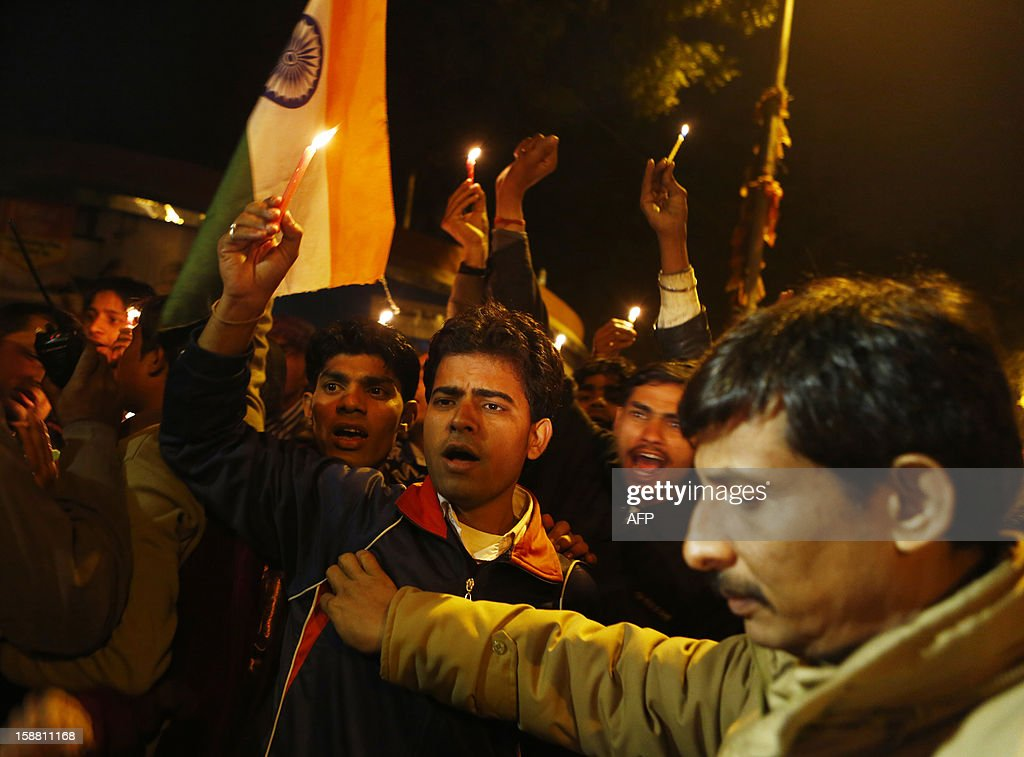 Indian protesters shout slogans as they are blocked by police during a rally in New Delhi on December 30, 2012, following the cremation of a gangrape victim in the Indian capital. The victim of a gang-rape and murder which triggered an outpouring of grief and anger across India was cremated at a private ceremony, hours after her body was flown home from Singapore. A student of 23-year-old, the focus of nationwide protests since she was brutally attacked on a bus in New Delhi two weeks ago, was cremated away from the public glare at the request of her traumatised parents. AFP PHOTO/ ANDREW CABALLERO-REYNOLDS