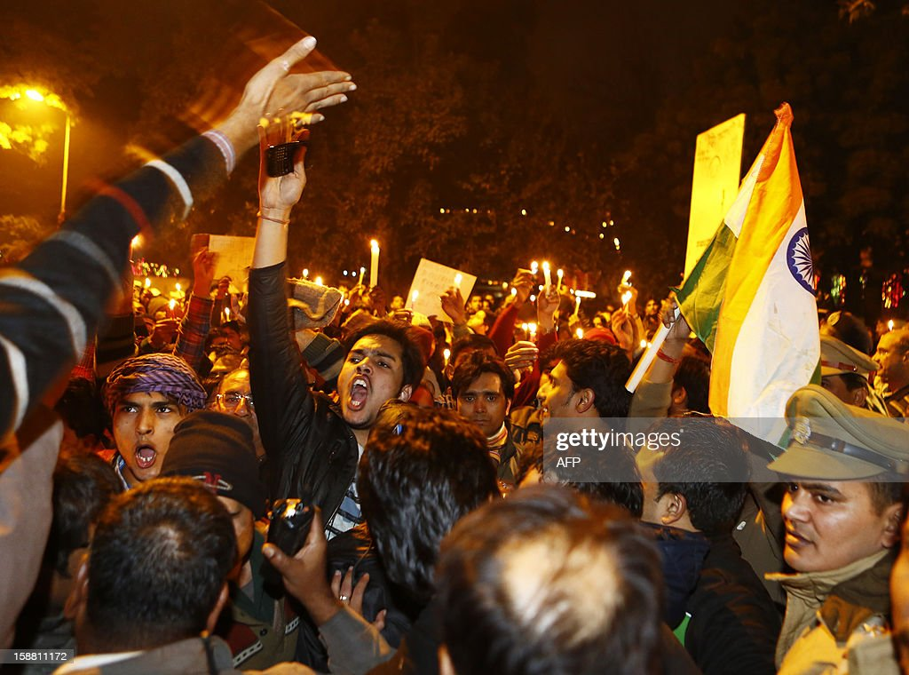 Indian protesters shout slogans during a rally in New Delhi on December 30, 2012, following the cremation of a gangrape victim in the Indian capital. The victim of a gang-rape and murder which triggered an outpouring of grief and anger across India was cremated at a private ceremony, hours after her body was flown home from Singapore. A student of 23-year-old, the focus of nationwide protests since she was brutally attacked on a bus in New Delhi two weeks ago, was cremated away from the public glare at the request of her traumatised parents.