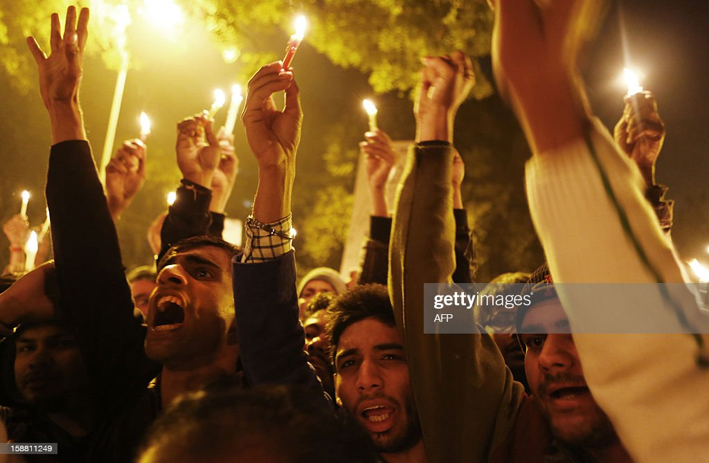 Indian protesters shout slogans during a rally in New Delhi on December 30, 2012, following the cremation of a gangrape victim in the Indian capital. The victim of a gang-rape and murder which triggered an outpouring of grief and anger across India was cremated at a private ceremony, hours after her body was flown home from Singapore. A student of 23-year-old, the focus of nationwide protests since she was brutally attacked on a bus in New Delhi two weeks ago, was cremated away from the public glare at the request of her traumatised parents. AFP PHOTO/ ANDREW CABALLERO-REYNOLDS