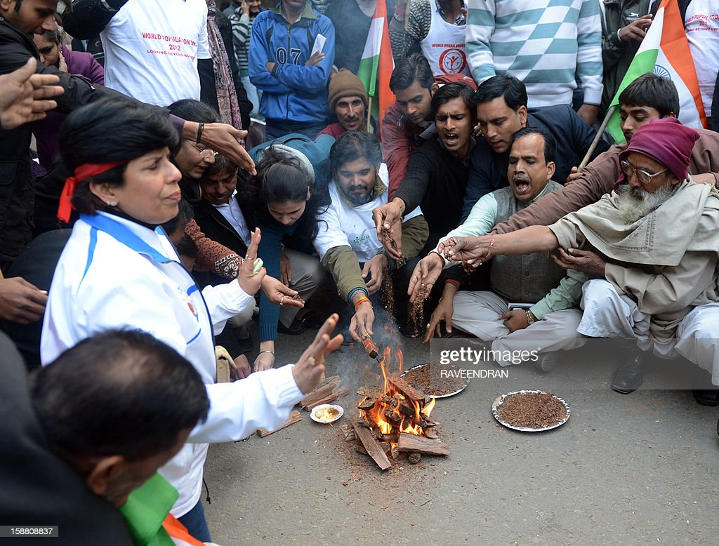 Indian protestors conduct a 'Havan' or fire ritual during a protest against the gangrape of a student in New Delhi on December 30, 2012. The victim of a gang-rape and murder which triggered an outpouring of grief and anger across India was cremated at a private ceremony, hours after her body was flown home from Singapore. A student of 23-years-old, the focus of nationwide protests since she was brutally attacked on a bus in New Delhi two weeks ago, was cremated away from the public glare at the request of her traumatised parents.