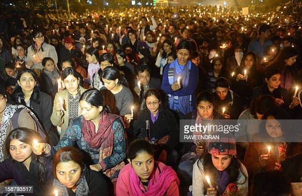 Indian protestors hold candles during a rally in New Delhi on December 29 after the death of a gang rape student from the Indian capital Indian...