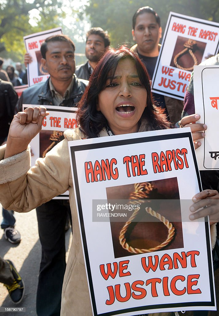 Indian protestors hold placards as they shout slogans during a protest demanding better security for women in New Delhi on December 29, 2012, as Indian leaders appealled for calm fearing fresh outbursts of protests after the death of a gang-rape student victim. New Delhi's top police officer and chief minister have urged people to mourn the death of a gang-rape victim in a peaceful manner as large parts of the city-centre were sealed off. The calls for calm came after an Indian woman who was gang-raped on a New Delhi bus died in a Singapore hospital after suffering severe organ failure.