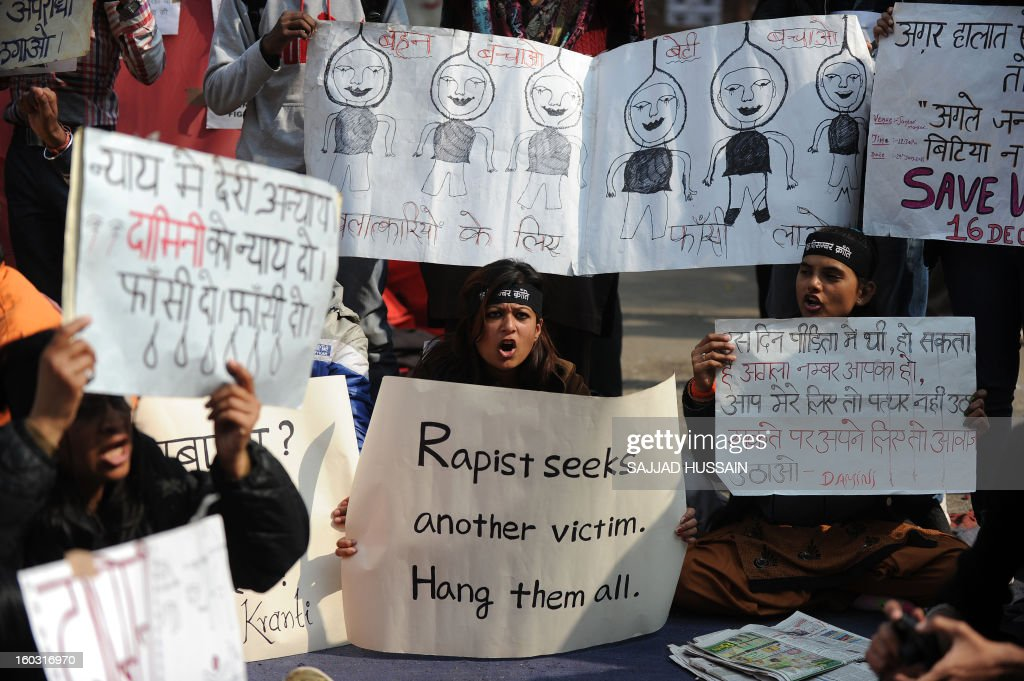 Indian protestors holds placards as they shout slogans during a protest against last month's gang rape and murder of a student, in New Delhi on January 29, 2013. India's Supreme Court rejected on Tuesday an application to move the trial of five men accused of the fatal gang-rape of a student on a bus in New Delhi.