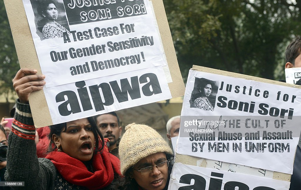 Indian protestors shout anti-government slogans during a protest against rape in New Delhi on January 2, 2013. The family of an Indian gang-rape victim said that they would not rest until her killers are hanged as police finalised their investigation before charges are laid against suspects this week. As the ruling Congress party reportedly pushed for tougher punishments for sex crimes, including chemical castration, authorities in New Delhi launched a hotline to improve safety for women in a city dubbed 'India's rape capital'. AFP PHOTO/RAVEENDRAN