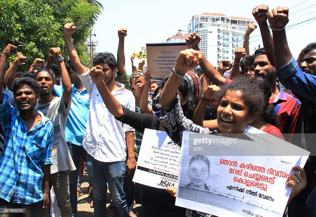 Indian protestors shout slogans during a demonstration against the rape and murder of a woman in Kochi on May 3, 2016. Indian police detained three people May 3 over the brutal rape and murder of a young student in the southern state of Kerala, in a case echoing the 2012 gang-rape of a Delhi woman that sparked mass protests. Police said the attack on the 30-year-old law student from the lowest Dalit caste was so vicious she was found lying dead in a pool of blood, her intestines hanging out. Her mother discovered her body at the family home in the southern state of Kerala. / AFP / STR