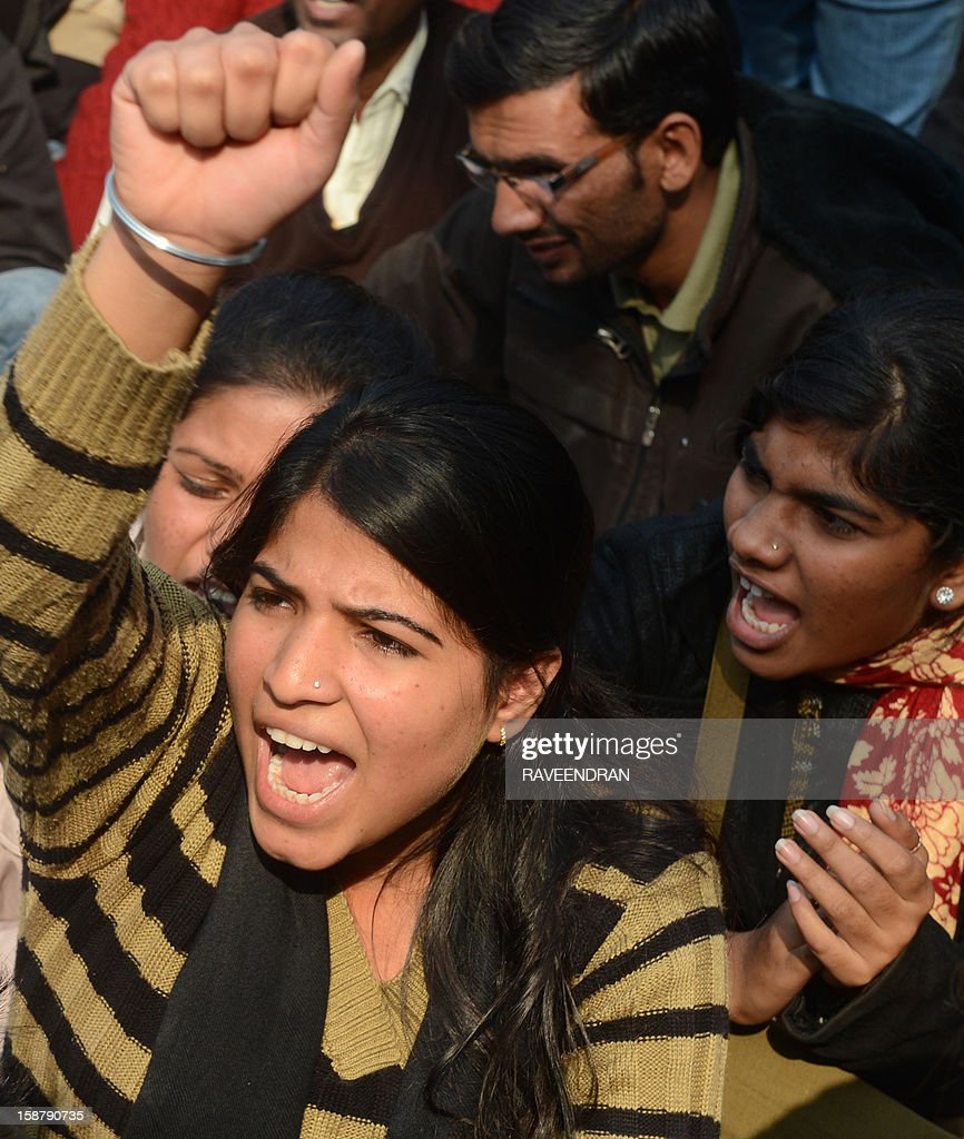 Indian protestors shout slogans during a protest demanding better security for women in New Delhi on December 29, 2012, as Indian leaders appealled for calm fearing fresh outbursts of protests after the death of a gang-rape student victim. New Delhi's top police officer and chief minister have urged people to mourn the death of a gang-rape victim in a peaceful manner as large parts of the city-centre were sealed off. The calls for calm came after an Indian woman who was gang-raped on a New Delhi bus died in a Singapore hospital after suffering severe organ failure.
