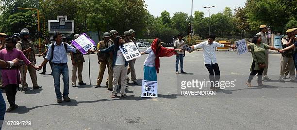 Indian protestors stop traffice during a demonstration against the rape of a fiveyear old girl in front of police headquaters in New Delhi on April...