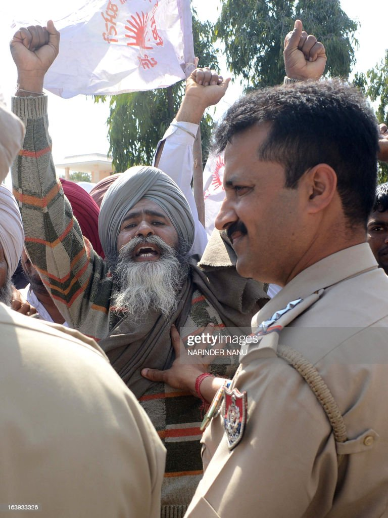 Indian Punjab police personnel push back farmers marching towards the Amritsar Deputy Commissioner office in Amritsar on March 18, 2013. Indian Punjab police personnel arrested scores of farmers who were protesting perceived anti-farmer policies imposed by the state government, and demanding the cancellation of a police case against farmers held for the alleged murder of a Punjab Police assistant sub-inspector at Tarn Taran.
