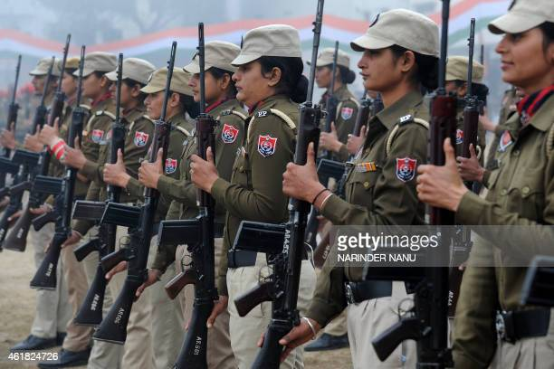 Indian Punjab state police women participate in a rehearsal for the upcoming 66th Republic Day parade in Amritsar on January 20 2015 India will...