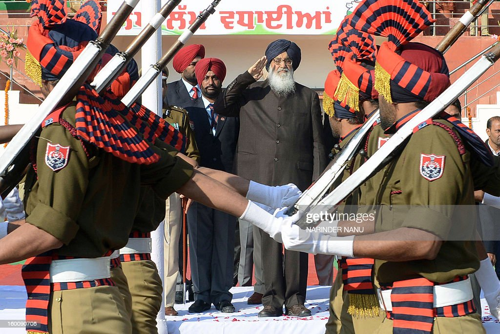Indian Punjab stateChief Minister Parkash Singh Badal salutes during a ceremony to celebrate India's 64th Republic Day parade at The Guru Nanak Stadium in Amritsar on January 26, 2013. India celebrated its 64th Republic Day with a military parade in several towns across the country. AFP PHOTO/NARINDER NANU