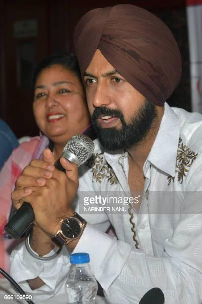 Indian Punjabi actor Gippy Grewal and actress Anita Devgan addresses a press conference for the upcoming Punjabi film 'Manje Bistre' in Amritsar on...
