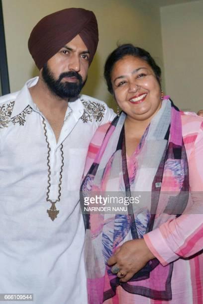 Indian Punjabi actor Gippy Grewal and actress Anita Devgan pose for the media at an event for the upcoming Punjabi film 'Manje Bistre' in Amritsar on...