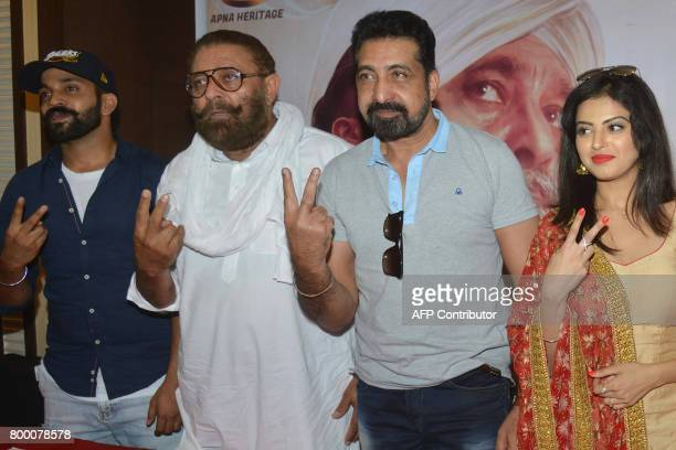 Indian Punjabi actors Dilpreet Dhillon Yograj Singh Ashish Duggal and Roshni Sahota pose for a picture during a promotional event for the upcoming...