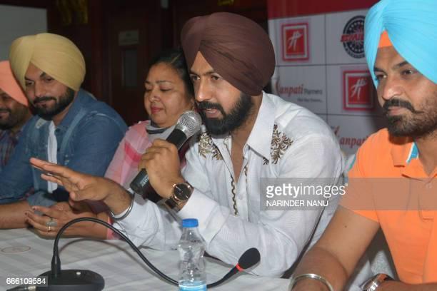 Indian Punjabi actors Gippy Grewal Jaggi Singh Harinder Bhullar actress Anita Devgan address a press conference for the upcoming Punjabi film 'Manje...