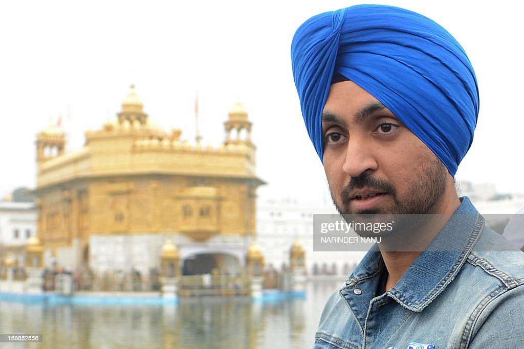 Indian Punjabi singer and actor Diljit Dosanjh poses during a visit to the Golden Temple in Amritsar on January 1, 2013.