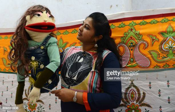 Indian Puppeteer from 'Meher' The Troupe group of puppeteers Amrita Zala poses with a muppet during a workshop on the occasion of World Puppetry Day...