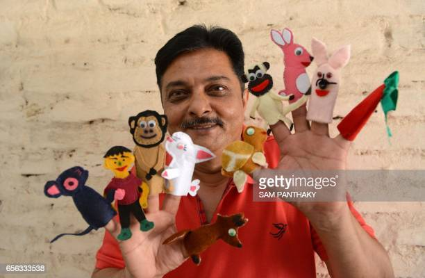 Indian puppeteer Mansinh Zala from 'Meher' The Troupe group of puppeteers displays children style finger puppets during a workshop on the occasion of...