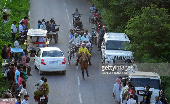 Indian racers take part in an Ekka race involving horse drawn carts which is organized every year during the holy Hindu month of Shravana in...
