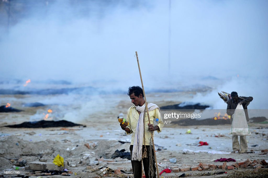 Indian ragpickers collect recycleable material from camping grounds near the Sangam following the conclusion of the Kumbh Mela in Allahabad on March 11, 2013. The Sangam is a holy bathing site during The Kumbh Mela, which runs from January till March, and takes place every 12 years in Allahabad while smaller events are held every three years in other locations around India. AFP PHOTO/Sanjay KANOJIA