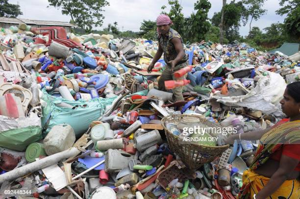 Indian ragpickers search for recyclable items at a plastic recycling station in Agartala the capital of the northeastern state of Tripura on June 5...