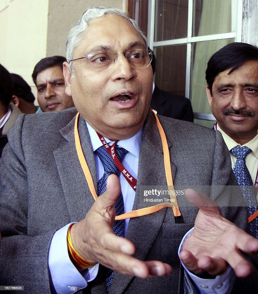 Indian railway board Chairman Vinay Mittal talking with media person after Railway Minister Pawan Kumar Bansal presented railway budget 2013 at parliament house on February 26, 2013 in New Delhi, India.