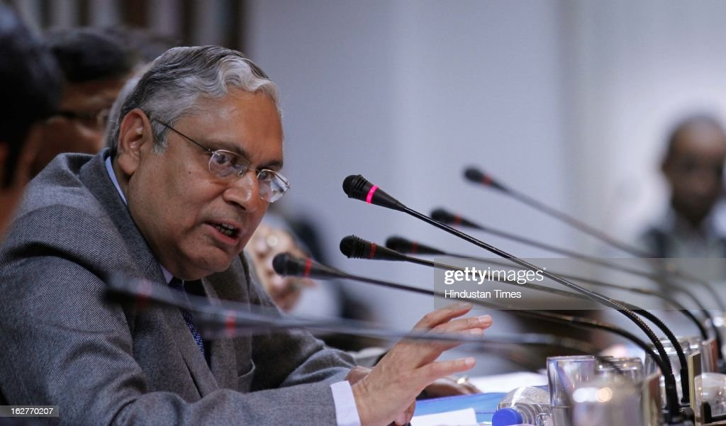 Indian Railway Board Chairman Vinay Mittal talking with media persons at Press conference after Railway Minister Pawan Kumar Bansal presented railway budget 2013 at parliament house on February 26, 2013 in New Delhi, India.
