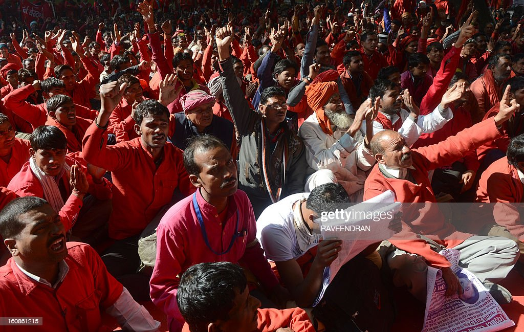 Indian railway coolies, porters, shout slogans during a protest in New Delhi on February 7, 2013. The luggage porters were demanding better wages, housing, medical and pension facilities before the Railways Budget is presented in the Parliament on February 24.