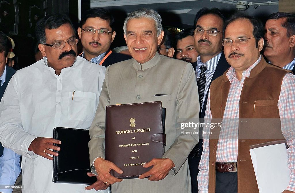 Indian Railway Minister Pawan Kumar Bansal (C) holding his Budget Speech as he walks towards Parliament to present the Indian Railway budget 2013-14, along with his Deputies J Surya Prakash Reddy (L) and Adhir Ranjan Chowdhury on February 26, 2013 in New Delhi, India.