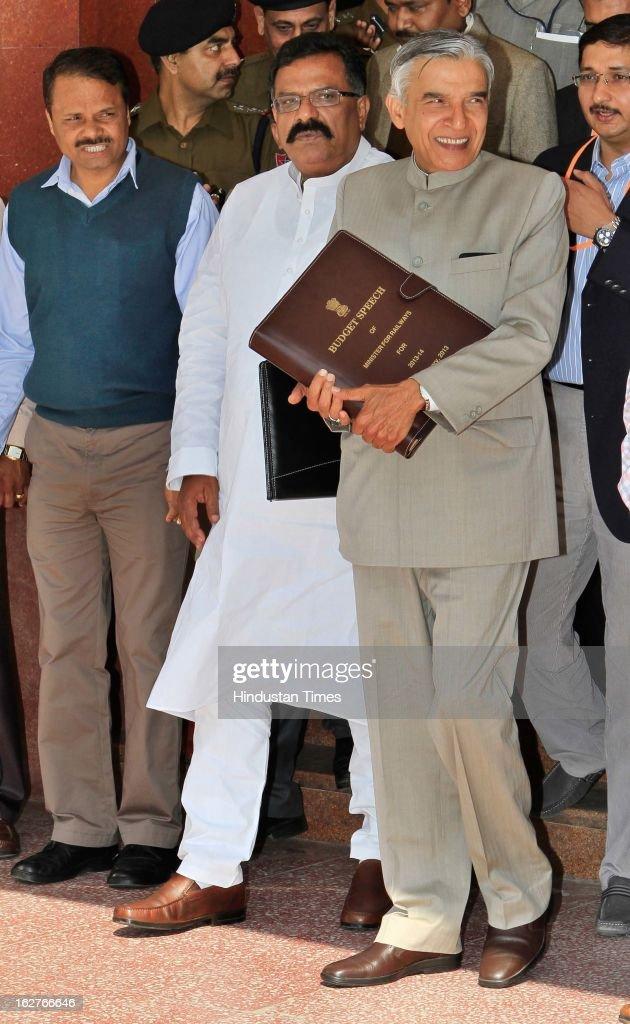 Indian Railway Minister Pawan Kumar Bansal (R) holding his Budget Speech as he walks towards Parliament to present the Indian Railway budget 2013-14, along with his Deputy J Surya Prakash Reddy (C) on February 26, 2013 in New Delhi, India.