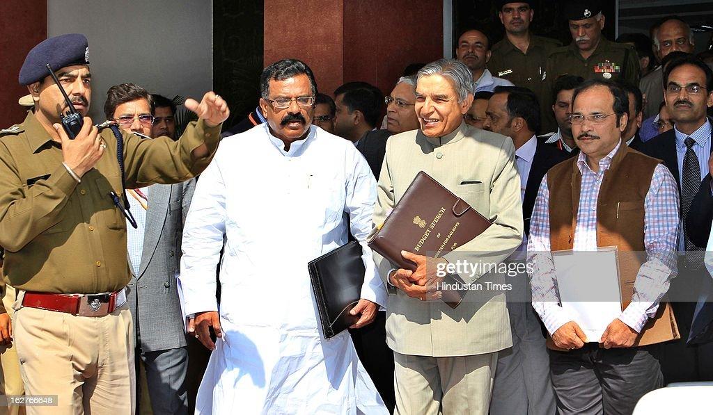Indian Railway Minister Pawan Kumar Bansal (C) holding his Budget Speech as he walks towards Parliament to present the Indian Railway budget 2013-14, along with his Deputies J Surya Prakash Reddy (L) and Adhir Ranjan Chowdhury on February 26, 2013 in New Delhi, India.