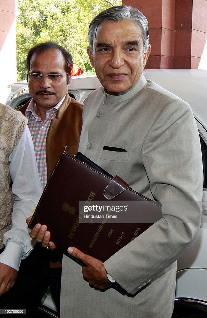 Indian Railway Minister Pawan Kumar Bansal holds up his Budget Speech as he arrive at Parliament to present the Indian Railway budget 2013-14, on February 26, 2013 in New Delhi, India.