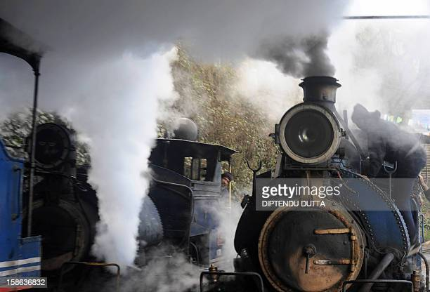 Indian railway workers maintain a steam engine of the Darjeeling Himalayan Railway train locally known as toy train in Darjeeling on December 22 2012...