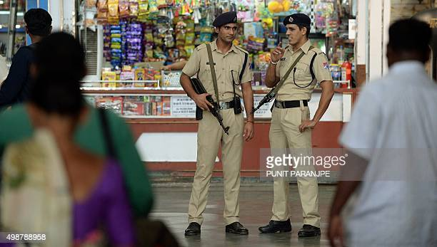 Indian railway's police personnel stand guard at the Chattrapathi Shivaji Terminus railway station one of the 2008 militant attack sites in Mumbai on...