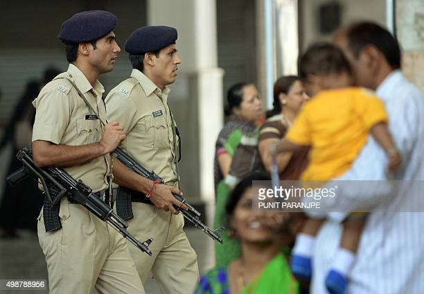 Indian railway's police personnel walk at the Chattrapathi Shivaji Terminus railway station one of the 2008 militant attack sites in Mumbai on...
