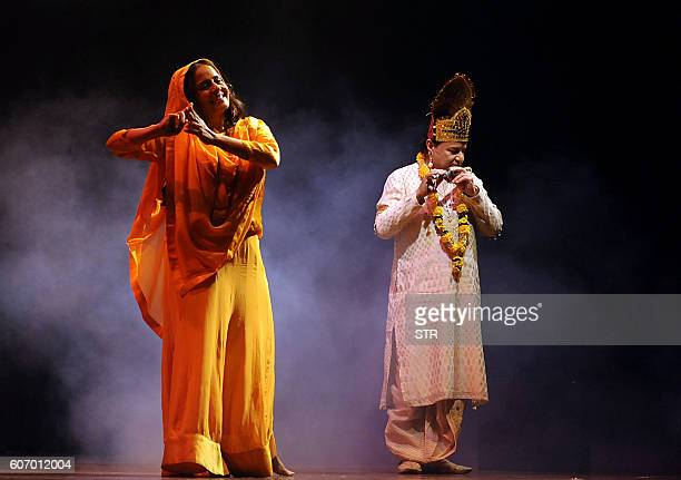 Indian Rajasthani folk singer Manesha Agarwal and Bhajan singer Anup Jalota take part in a perfomrance of the 'Main Hoon Meera' musical in Mumbai on...