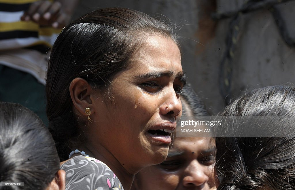 Indian relatives mourn Swapna Reddy who died in a bomb blast the night before in Hyderabad on February 22, 2013. Twin bombings in a busy shopping area are now known to have killed 14 people and wounded 119, a senior Indian minister said. Prime Minister Manmohan Singh said the perpetrators of the 'dastardly act' would be punished. AFP PHOTO / Noah SEELAM