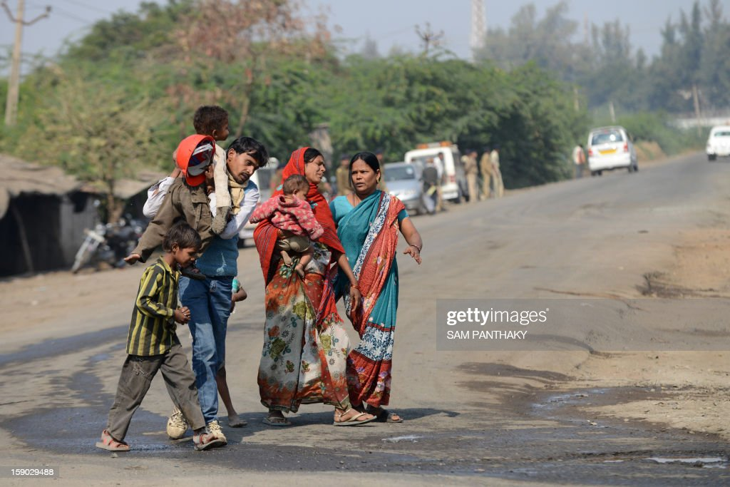 Indian relatives of 'Missing worker' Jalandhar Chaudhari react as they arrive at the Indian Oil Corporation (IOC) plant at the Indian Oil Corporation (IOC) plant at Hajira near Surat, some 275 kms from Ahmedabad on January 6, 2013. Three persons were killed in a major fire in a storage tank of IOC terminal, which was contained after a 21-hour operation by fire brigade team, officials said according to the Press Trust of India (PTI). AFP PHOTO / Sam PANTHAKY