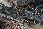 Indian rescue workers and volunteers work to find surviviors among the wreckage of a collapsed flyover bridge in Kolkata on March 31 2016 At least 14...
