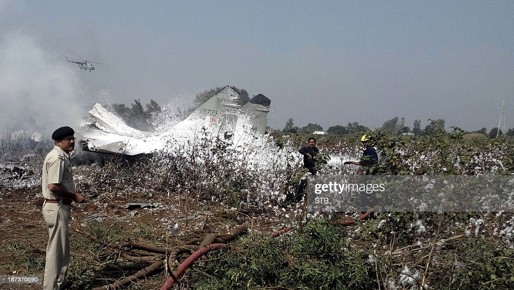 Indian rescue workerS douse a burning Indian Air Force (IAF) MiG 29 aircraft, which crashed near Jamnagar airbase, some 350 kms from Ahmedabad on November 8, 2013. The pilot, who was airborne on a routine flying training sortie, ejected safely. There is no reported damage on the ground to any civil life or property and a Court of Inquiry has been ordered to investigate the cause of the accident.