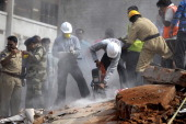 Indian rescue workers move the rubble as they search for victims at the site of the City Light Hotel building collapse in Secunderabad the twin city...