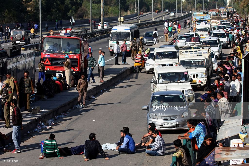 Indian residents from the Jat community block the Chandigarh-Shimla highway amid violent caste protests in Panchkula on February 21, 2016. Ten people have died in caste protests which triggered widespread arson and looting in a north Indian state, police said February 21, as New Delhi faced a water crisis after mobs shut down a key supply. Thousands of troops with shoot-on-sight orders were deployed on February 20 in Haryana state, a day after week-long protests turned violent with rioters setting fire to homes and railway stations and blocking highways.