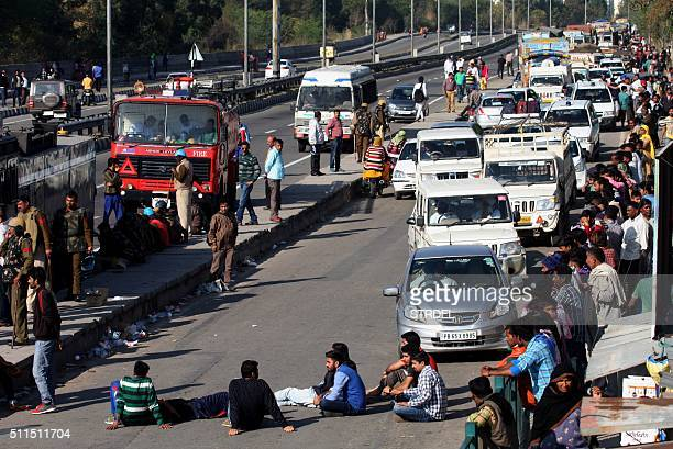 Indian residents from the Jat community block the ChandigarhShimla highway amid violent caste protests in Panchkula on February 21 2016 Ten people...